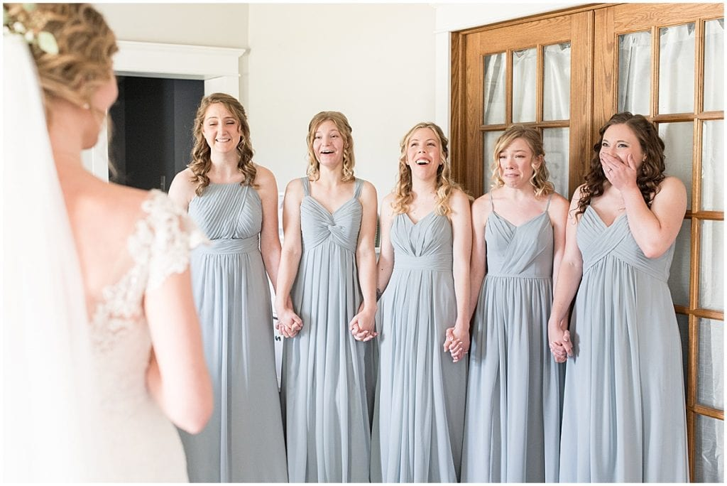 Bride first look with bridesmaids before wedding at The Matterhorn in Elkhart, Indiana