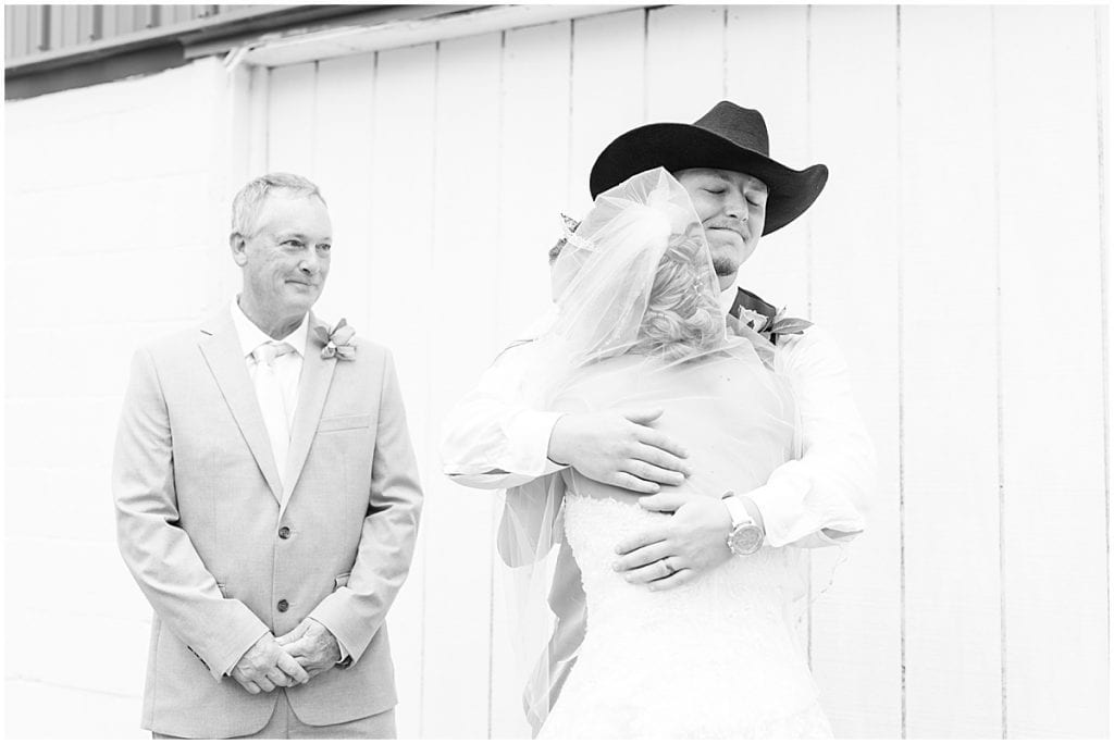 Bride's first look with her dad and brother before wedding at Wea Creek Orchard in Lafayette, Indiana