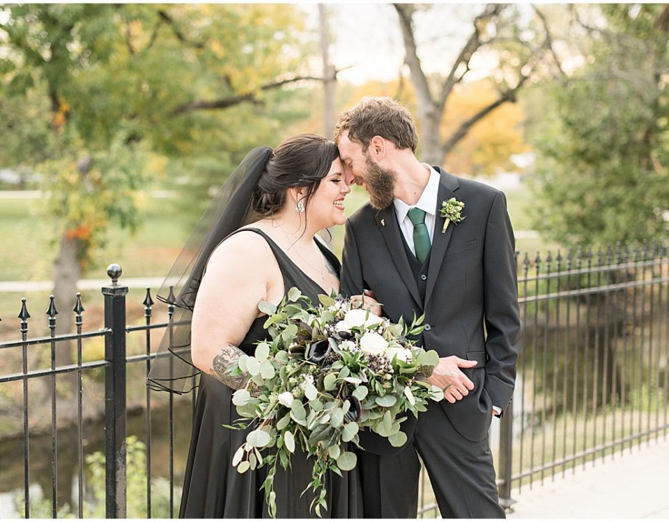 Bride and groom next to water after wedding in Rensselaer, Indiana