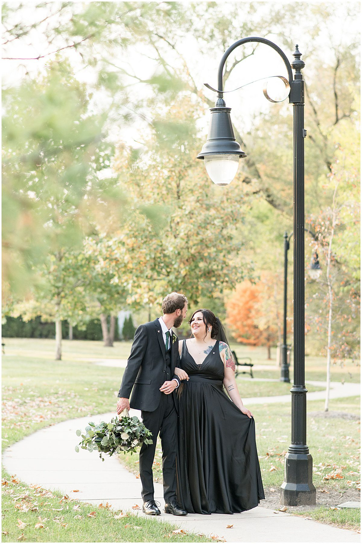 Just married photos after eMbers Venue wedding in Rensselaer, Indiana with a bride wearing black by Victoria Rayburn Photography