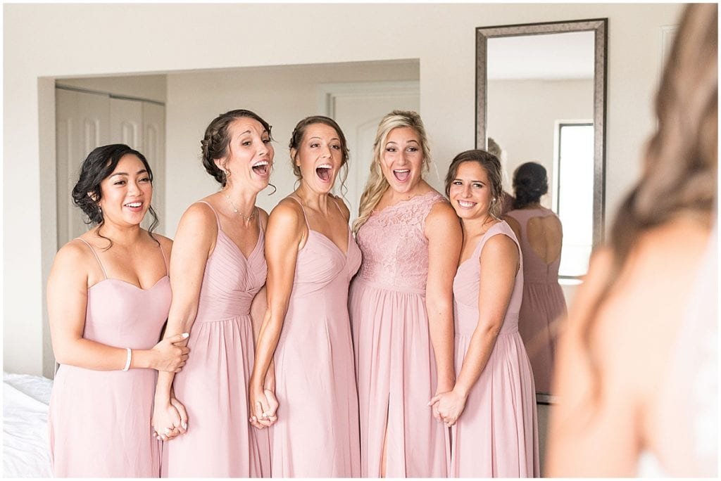 Bridesmaids reaction at wedding at The Lighthouse Restaurant in Cedar Lake, Indiana by Victoria Rayburn Photography