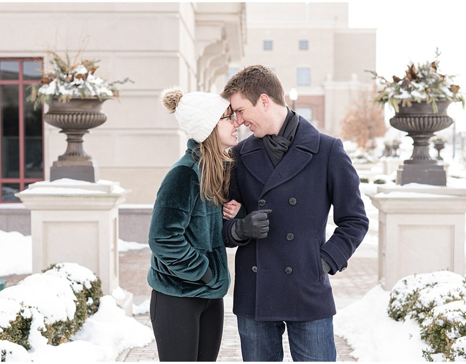 Newly engaged couple poses for photos after proposal at The Palladium in Carmel, Indiana
